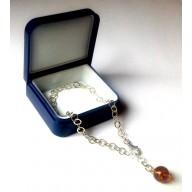 Srebrna bransoletka z bursztynowym koralikiem